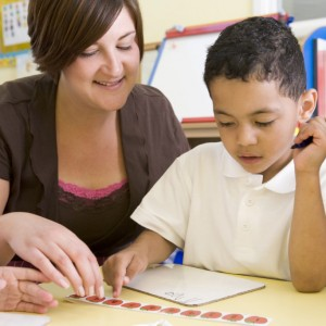 Teacher helps boy count