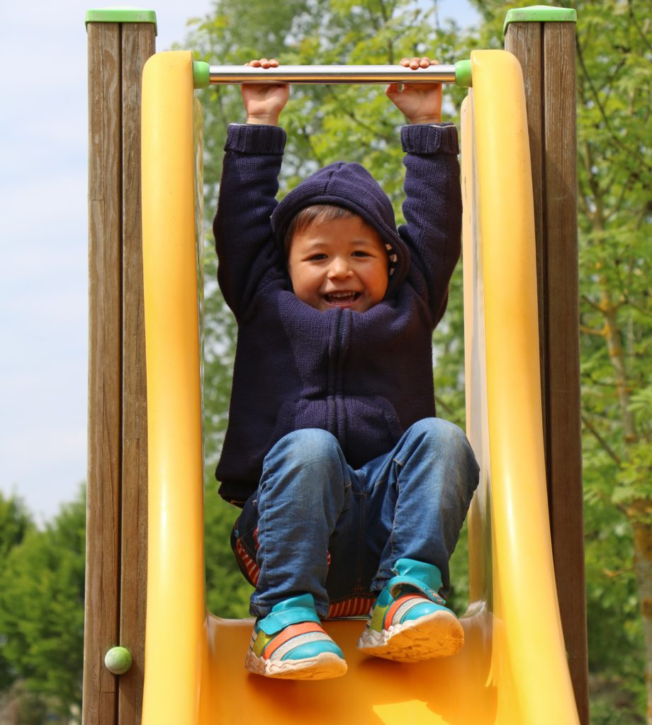 Toddler playing on slide