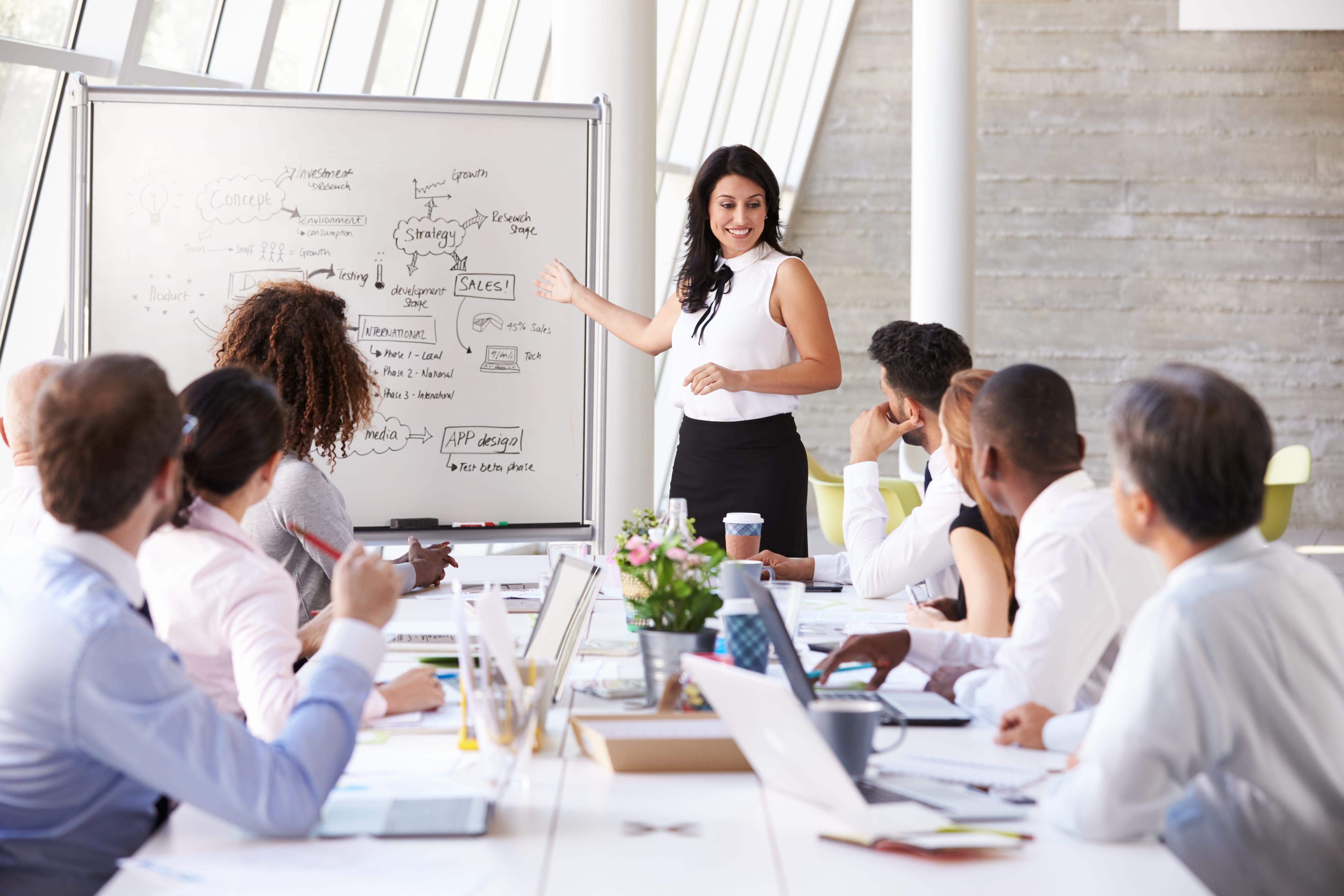 Hispanic Businesswoman Leading Meeting