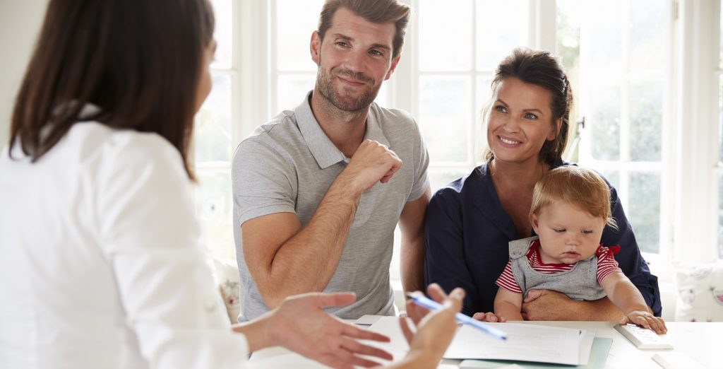 Family With Baby Meeting Advisor At Home